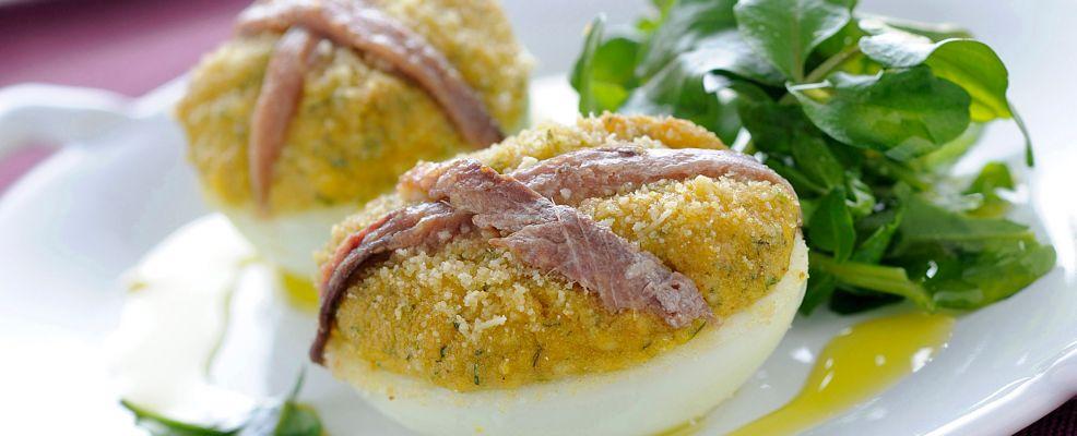 Uova ripiene gratinate sale pepe for Cucinare uova sode