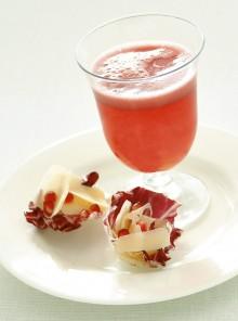 Il cocktail allo spumante e lamelle di grana