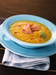 La crema di carote con mezzelune di prosciutto