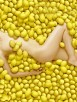 Caucasian woman laying in pile of lemons