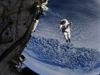 Shuttle Astronaut Conducting Space Walk