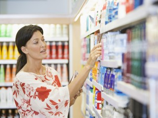 Caucasian woman shopping in drugstore