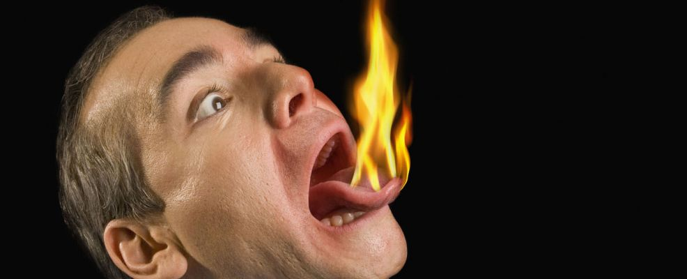 Businessman's tongue on fire