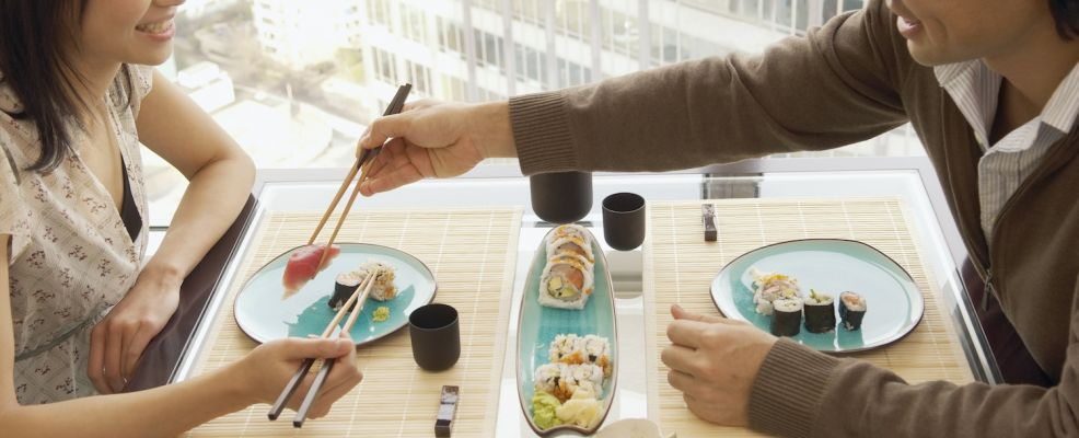 Couple sharing sushi