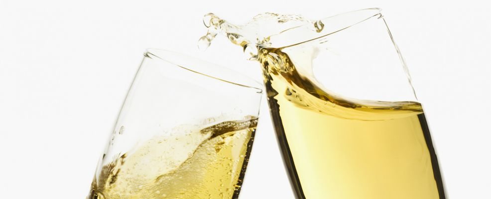 Close-up of two flutes of champagne