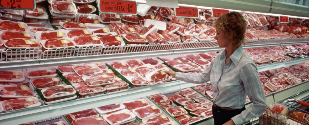 Shopper Selects Meat in Supermarket
