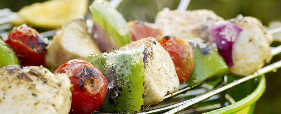 Chicken and Vegetable Kebabs Roasting Over Bucket