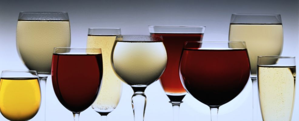 Row Of Assorted Red And White Wines In Wine Glasses