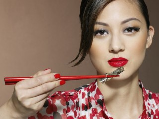 Woman Holding Grasshopper with Chopsticks