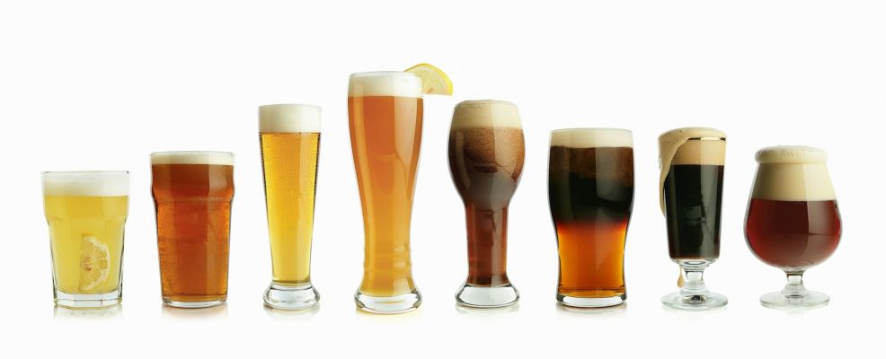 Assorted Types of Beer in Glasses, In a Row on White Background