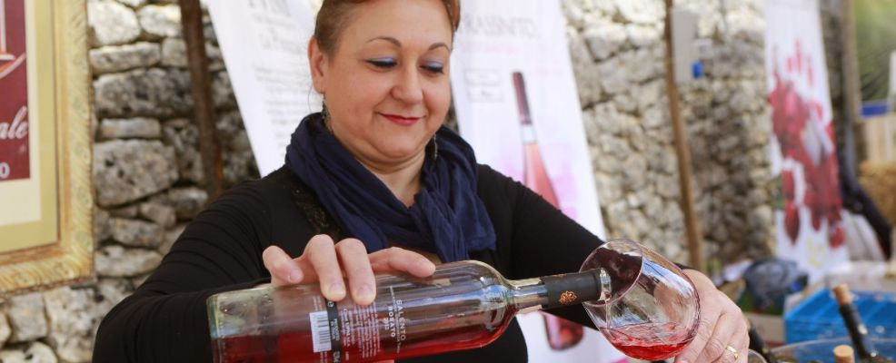 wine tasting at a farmers' products fair, Locorotondo, Puglia, Italy