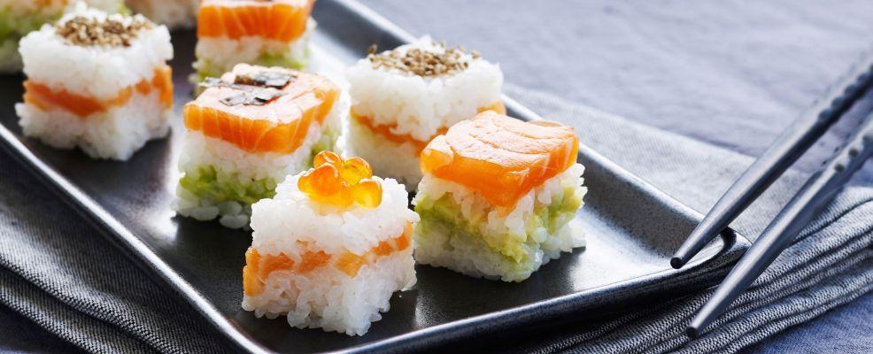 Homemade sushi with salmon and avocado