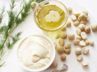 Still life of macadamia oil, mayonnaise with macadamia nuts