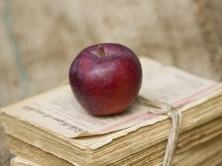 Apple on stack of old books