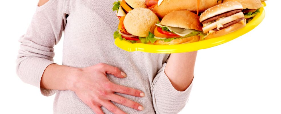 14742420 - sad woman get abdomen pain after eating fatty food. isolated.