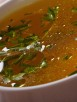 40235471 - tasty meat broth with parsley in white bowl close-up. horizontal