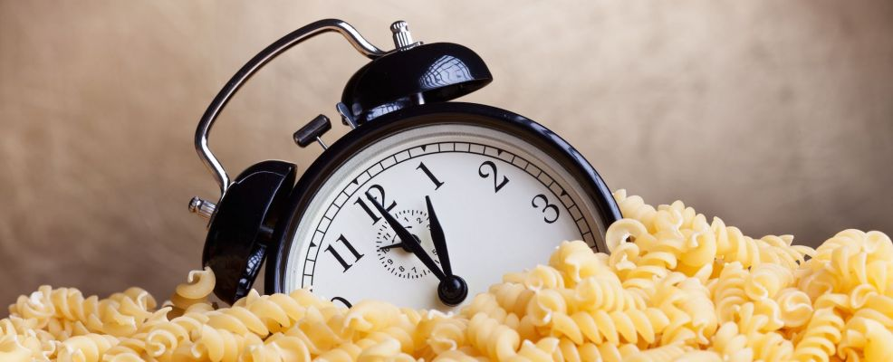 14258128 - time for pasta - alarm clock covered with pasta