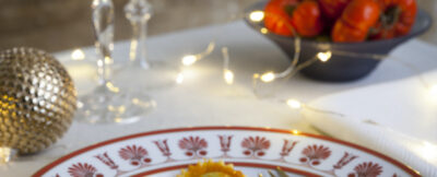 Tortelli ai fondi di carciofo e caprino con salsa vellutata di arancia e pomodori